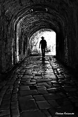 Corfu (Eleanna Kounoupa) Tags: blackandwhite bw doors gates silhouettes tunnel greece corfu stoa ionianislands oldfortress  blackwhitephotos  historiccitycenter  hccity