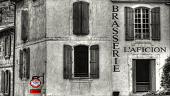 Brasserie L`aficion (Andy Gant) Tags: windows red blackandwhite bw france building window sign architecture buildings mono architecturaldetail oldbuildings shutters shutter provence arles southoffrance bwphotography brasserie selectivecolour bweffect architectureinpixels architecturalfragments hww architecturallines bwimages oldandbeautiful bwimagesfromaroundtheworld