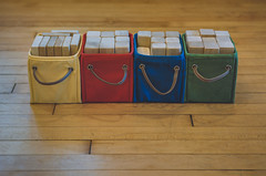 Smiling Block Bins (ScottNorrisPhoto) Tags: usa smile wisconsin children toys happy play box objects indoor stack full container milwaukee imagine build primarycolors woodfloor woodenblocks stilllifephotography leatherstrap 365project scottnorrisphotography clothbin
