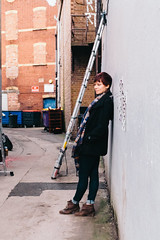 Bristol; January 2016 (Daniel Durrans) Tags: street urban woman wall lady bristol alley streetphotography redhead chain alleyway ladder redhair leaning scalf