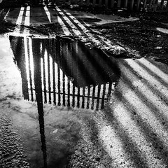 Northern_Soul (PJT.) Tags: road shadow sky reflection apple tarmac clouds liverpool fence grit puddle bottle dock stripe can pole litter dirt burst merseyside debri