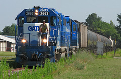 Pulling through Chesaning (GLC 392) Tags: morning sun cars saint st mi point weeds branch tank great elevator central over lakes charles storage rare grown glc protecting emd gp382 gatx 2663 chesaning 2675 michian gmtx