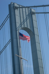 Verrazano-Narrows Bridge (Erin Cadigan Photography) Tags: auto road city nyc newyorkcity bridge blue red white newyork tower vertical architecture brooklyn river stars outdoors bay harbor daylight traffic suspension steel stripes flag bluesky cable double structure deck american transportation transit toll vehicle mta borough daytime hudson statenisland span narrows roadway verrazano verrazanonarrows fortwadsworth