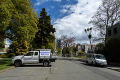 Dust and Clouds (Jocey K) Tags: street trees newzealand christchurch clouds buildings demolition van cabbagetree