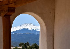 Stations of the Cross, San Luis Colorado (KWinters Photography) Tags: wood blue red sky snow mountains church window colors architecture nikon colorado shrine arch outdoor structure sanluis walls nikkor