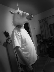 contemplating unicorn (Karol Franks) Tags: california bw animal losangeles mask creepy unicorn makebelieve lostinthought