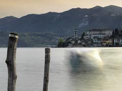 Boat landing in Orta (marco boff) Tags: sunset lake water reflections landscape lago sundown hasselblad orta lagoorta ortasangiulio ortalake leefilters