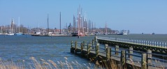 The harbor of Enkhuizen in the Netherlands (Stan de Haas Photography) Tags: city morning autumn sun lighthouse holland reflection netherlands colors dutch port sunrise landscape harbor town outdoor background ships yachts enkhuizen ijsselmeer standehaas