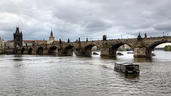 Cute tourboat (Peter Nystroem) Tags: city bridge river boat europe prague cloudy praha czechrepublic charlesbridge vltava karlvmost april2016