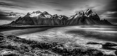 Vestrahorn in Black and White (Nick L) Tags: blackandwhite bw seascape clouds canon landscape eos iceland scenic 5d serene vestrahorn southerniceland stokksnes southeasticeland vesturhorn brunnhorn eos5dmarkiii 5d3 kambhorn eos5dmark3 plutonicgabbro