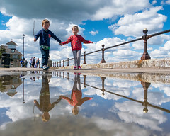 Best Friends on Cowes Parade - DSCF7996 (s0ulsurfing) Tags: friends clouds reflections fuji april fujifilm holdinghands toddlers isle cowes wight 2016 s0ulsurfing xt1