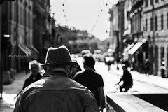 Soleggiato (Gioia & Andrea) Tags: street city light shadow people blackandwhite sun white black reflection hat bike photography gray ferrara castello sinlight soleggiato