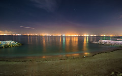 Jupiter (arnabjosephite) Tags: ocean blue light sea sky people reflection beach yellow clouds port stars sand singapore ships