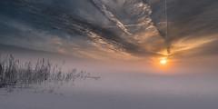 Lost on thin ice 4 (piotrekfil) Tags: winter sunset sky mist lake ice nature fog clouds landscape pentax poland sigma1750mmf28 piotrfil