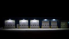 Puddle of light (frostnip907) Tags: lighting blue yellow alaska night rural industrial garage