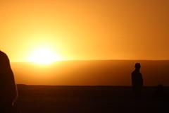 Sun's Silhouette (Alison Claire~) Tags: chile travel sun travelling nature yellow set america canon de landscape outdoors person eos eclipse san warm desert outdoor south pedro atacama traveling setting canoneos salar 600d canoneos600d