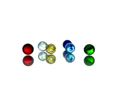 Happy Colours (nikagnew) Tags: blue red white reflection green glass yellow bright circles shapes highkey marbles spheres