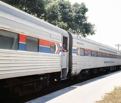 Amtrak Champion is seen while departing westbound from the station platform at Winter Park, Florida (alcomike43) Tags: old color classic station vintage photo platform slide trains historic 106 amtrak photograph rails depot porter traps railroads rightofway dutchdoor mainline 2781 sleepingcar passengertrains winterparkflorida darlingtoncounty pullmanstandard amtrakchampion conventionallightweightpassengercars carattendant