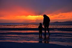 Mother and Child splashing on the beach (Matt Burke) Tags: sunset sea castle beach background gorgeous sands blackrock porthmadog criccieth