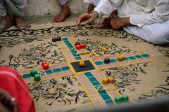 A group of men play a game of Chopat on the banks of the Yamuna in Mathura, India (Royd Tauro) Tags: travel india dice evening nikon culture streetphotography games entertainment backpacking boardgame holi d800 mathura northindia adobelightroom chopat
