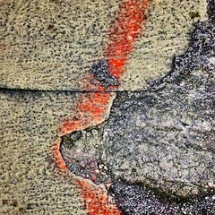 Abstract pavement (Beth Reynolds) Tags: road street red abstract texture lines paint pavement curves cracks