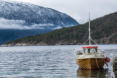 Lonely fishing boat (imagesbystefan.com) Tags: ocean wood travel sea wild vacation mist mountain tree nature water beautiful norway fog forest woodland coast boat wooden woods scenery view natural background small hill peak scene line norwegian adventure explore fjord serene wilderness scandinavia range slope fhishing