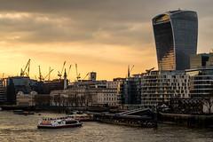 Walkie Talkie Sunset (Neal_T) Tags: city uk sunset sky london architecture clouds reflections river 50mm boat construction fuji crane norfolk norwich fujifilm londoncity walkietalkie themes newarchitecture vintagelens riverthemes xt1