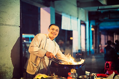 Shanghai Alleyway Chef (Jon Siegel) Tags: china street food man cooking smiling night fire 50mm evening cool alley nikon shanghai badass 14 working chinese sigma kind master chef alleyway dining streetfood wok d810 streetchef sigma50mmf14art