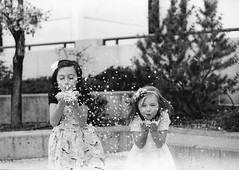 Sisters and Petals (melody_hoover) Tags: portrait people blackandwhite film outdoors blackwhite nikon joy naturallight carsoncity bwfp flfrok