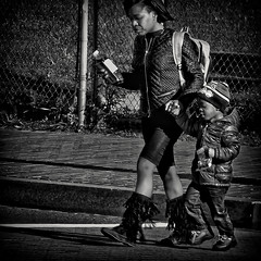 """A Multitasking Mother, """"Reading A Text, Walking The Boy, And Crossing The Street In Traffic"""", Historic Anacostia, Washington, DC (Gerald L. Campbell) Tags: street urban bw love youth digital washingtondc blackwhite dc community citylife streetphotography squareformat spirituality socialdocumentary urbanphotography youngboy socialmedia yeswecan historicanacostia canonsx50hs"""