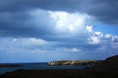 Ile de Keller (Ingrid) Tags: light sea cloud sun mer island soleil contraste nuages couch le