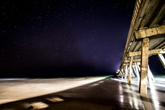 Under the Stars (L.Grey Photography) Tags: ocean sky beach nature water night canon stars rebel pier nc outdoor astrophotography wilmington sl1 wrightsville 10mm rokinon