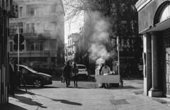 Sevilla (lvaroRo) Tags: street white black blanco shadows y smoke negro monochromatic urbana humo monocromtico callejeo
