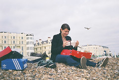 shoe shopping in Brighton 1 (Siv Nilsen) Tags: woman film beach analog 35mm shopping lomo shoes seagull pebbles analogue adidas 8m smena pleased