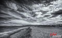 Spey Bay... (leeb.black) Tags: white black bay scotland pebbles spey fochabers
