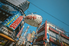 Shinsekai_1 (hans-johnson) Tags: city blue sky urban japan asia   nippon osaka fullframe kansai nihon   shinsekai 1635 tsutenkaku kinki  aozora naniwa  eos5d       5d3