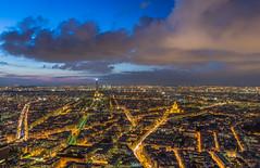 Seven hundred feet over Paris (aurlien.leroch) Tags: longexposure sunset paris france night clouds nikon cityscape eiffeltower over bynight invalides toureiffel arcdetriomphe ladéfense twlight tourmontparnasse grandpalais d7100 prayforbelgium