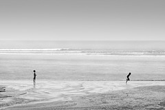 why you running mate !!! (R.I.Jewel) Tags: boys water blackwhite play bangladesh coxsbazar