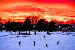 Sunset at Sled Hill (Wes Iversen) Tags: trees houses winter people kids photomanipulation illinois silhouettes sunsets sleds mountprospect hss nikkor24120mm sliderssunday