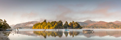 Derwent Dawn (Dave Fieldhouse Photography) Tags: morning autumn mountains clouds sunrise reflections landscape boats dawn nationalpark lakedistrict cumbria derwentwater stillwater nationaltrust keswick catbells stitchedpanorama boatshouse lancashirelife
