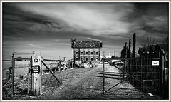 Oyster Bay House, Faversham (Jason 87030) Tags: uk greatbritain england white holiday black building history water coffee architecture creek fence bench mono kent picnic noir moody unitedkingdom gates scene gritty april alpha blanc faversham 2016 ilce oysterbayhouse standardquay sonya6000