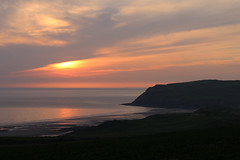 St Bees sunset (Cumberland Patriot) Tags: sunset sea sky irish orange cliff cloud sun beach water st set clouds head bees cliffs shore solway firth stbees