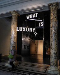 What is Luxury? (Steve Taylor (Photography)) Tags: uk greatbritain england woman brown black london art sign museum architecture walking women shiny unitedkingdom va gb what column marble handbag luxury lux victoriaandalbert