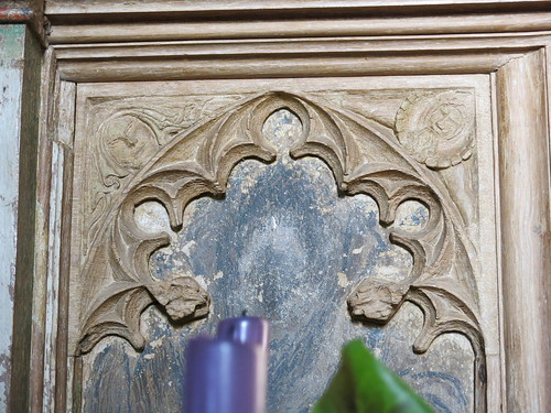 Face carvings on manorial pew panelling - once part of a parclose screen