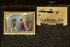 Using a Nikon D7000 to take a picture of a Box Brownie taking a picture of me using a Praktica Nova to take a picture of a Nikon FM2n taking a picture of a Nikon D7000 taking a picture of a Box Brownie... (Apionid) Tags: camera selfportrait macro nova kodak praktica viewfinder boxbrownie fm2n werehere day42366 nikond7000 hereios 366the2016edition 3662016 11feb16