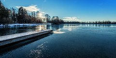 Cold lake (Martin Zurek) Tags: travel blue trees sky panorama sun lake color reflection ice nature water clouds zeiss germany landscape bavaria see quiet peace walk peaceful fürstenfeldbruck leisure distagon olching olchingersee 5ds distagont2815 canon5dsr 5dsr