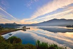 Morning glow at Sun Moon Lake (Vincent_Ting) Tags: morning sunset sky lake water clouds sunrise dawn pier taiwan galaxy   crepuscularrays  sunmoonlake                  vincentting