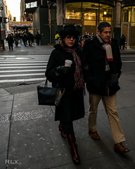 Square Stroll (ryanlandell) Tags: city nyc people urban woman man black men art hat bag walking photography hoodie women shades jacket fujifilm smirk 16mm 7thave rlx xt1 myfujifilm xf16mmf14 rlxpress