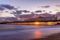 Brighton Pier (vrod2012) Tags: uk longexposure travel sunset england seascape beach landscape evening pier seaside brighton dusk pebbles sunburst visiting southcoast seashore starburst