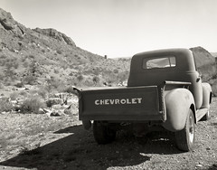 Chevy Truck (magnetic_red) Tags: old mountains west chevrolet abandoned truck desert nevada chevy rusted largeformat tmax100 crowngraphic americanclassic caffenol ektar135mmf47